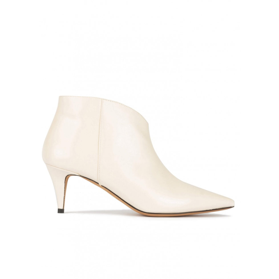 Mid heel point-toe ankle boots in off-white leather