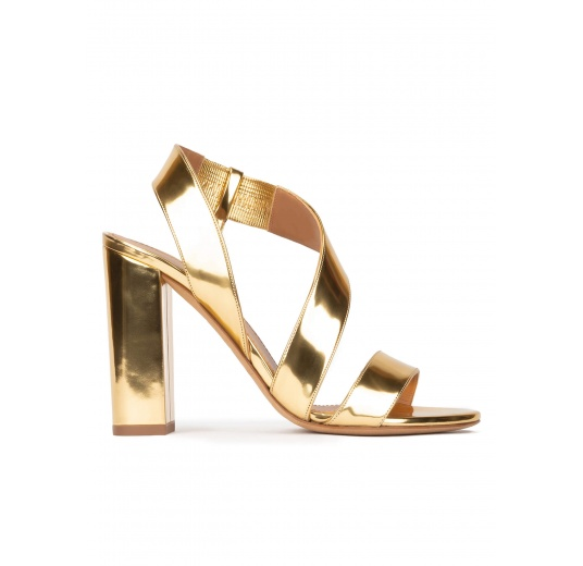 Gold strappy high block heel sandals in mirrored leather Pura López