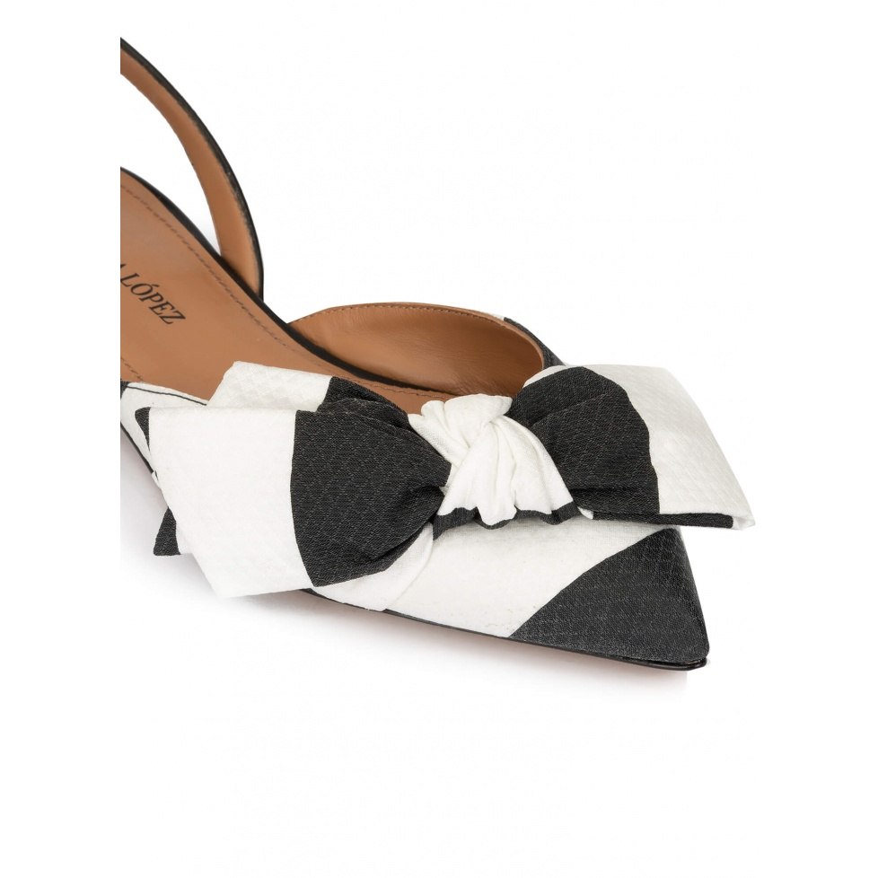 Bow detailed point-toe flats in black and white fabric