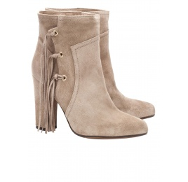 High heel ankle boots in taupe suede with fringes Pura López
