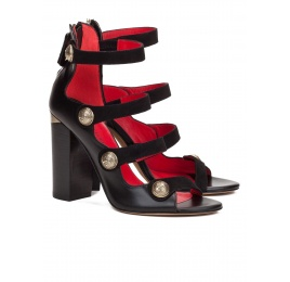 High block heel sandals in black leather with metal buttons Pura López