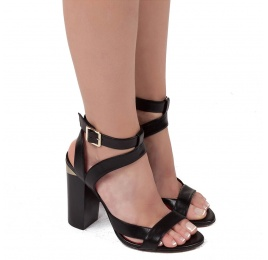 Strappy high heel sandals in black leather Pura López