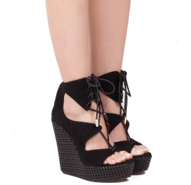 Lace-up wedge sandals in black suede Pura López