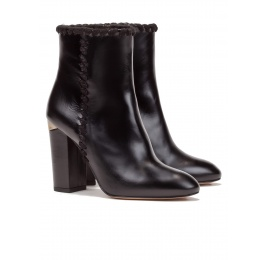 High block heel ankle boots in black leather Pura López