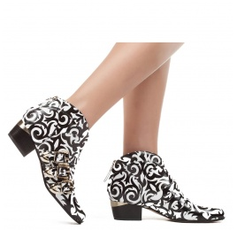 Mid heel ankle boots in black printed white leather Pura López