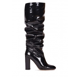 Slouchy knee-high block heel boots in black patent Pura López