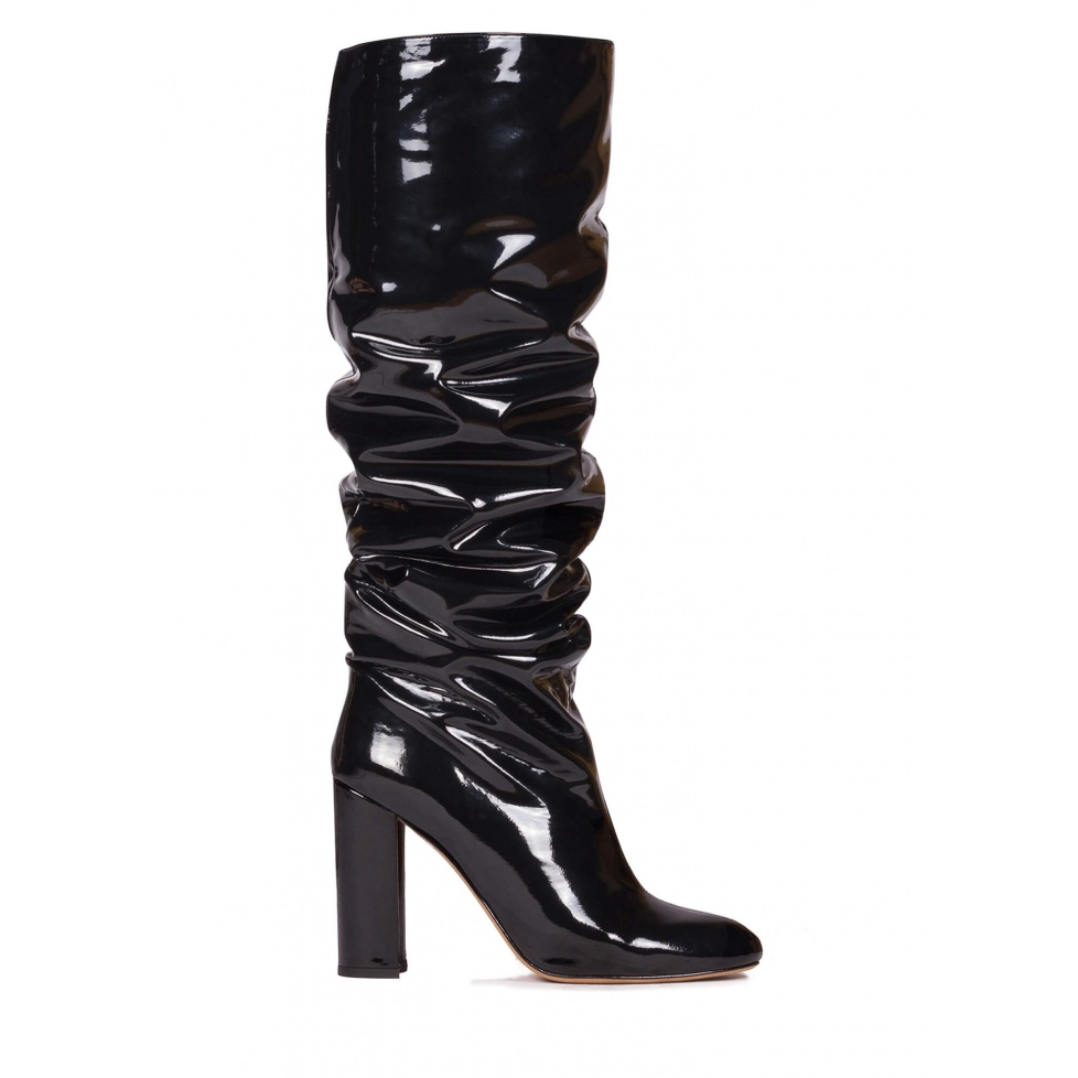 Slouchy knee-high block heel boots in black patent