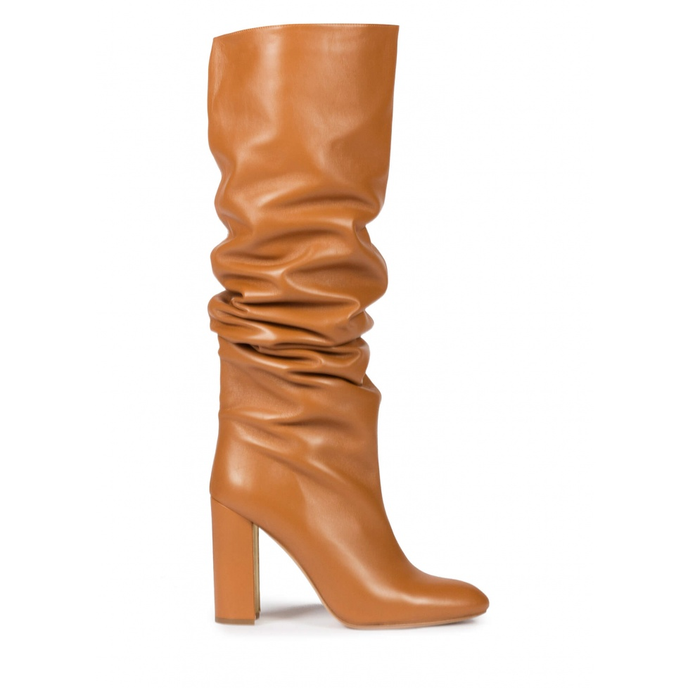 Slouchy knee-high block heel boots in camel leather