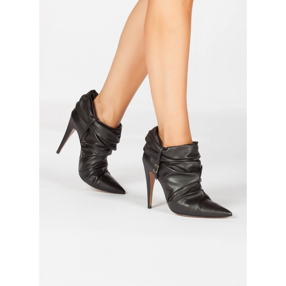 Slouchy heeled pointy toe ankle boots in black leather