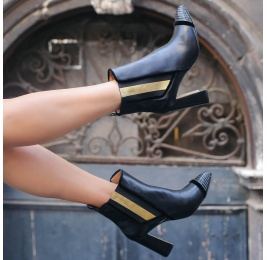 Black leather high block heel ankle boots with elasticated panel Pura López
