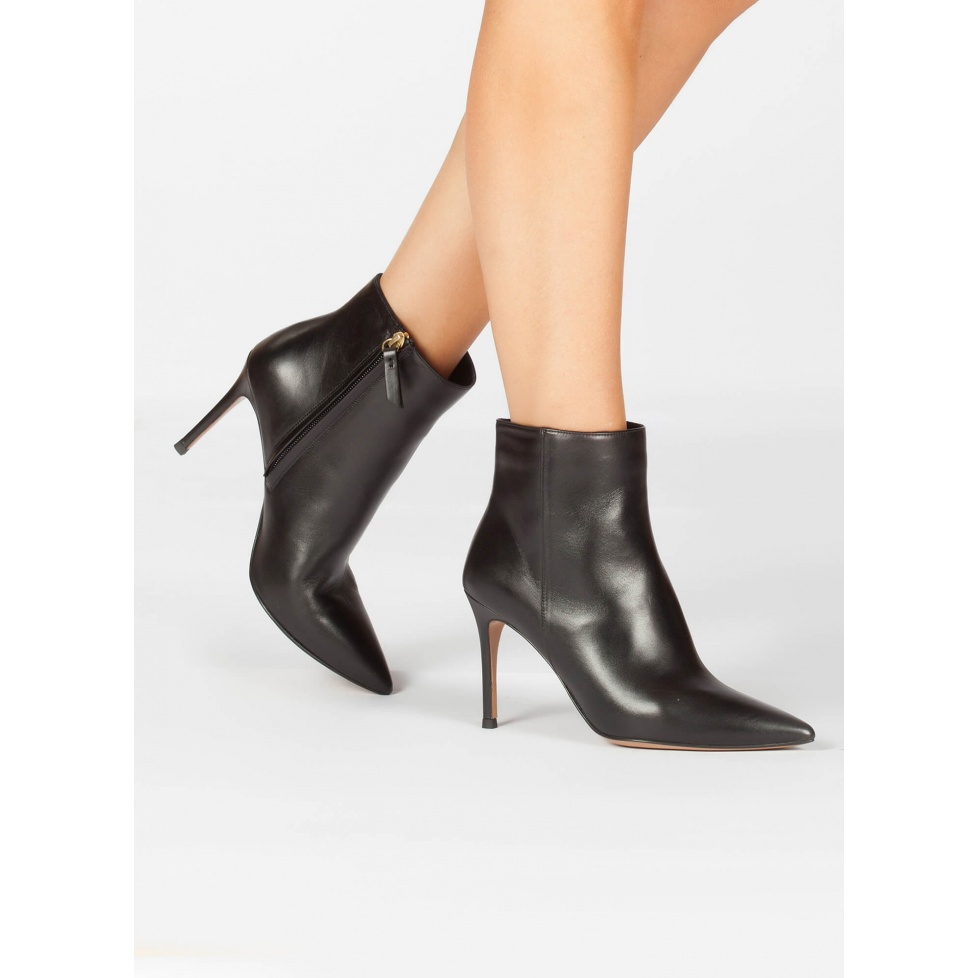 High heel point-toe ankle boots in black leather