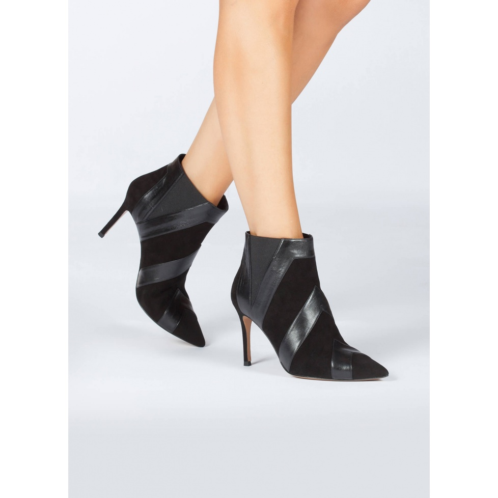 Black heeled pointy toe ankle boots in suede and leather