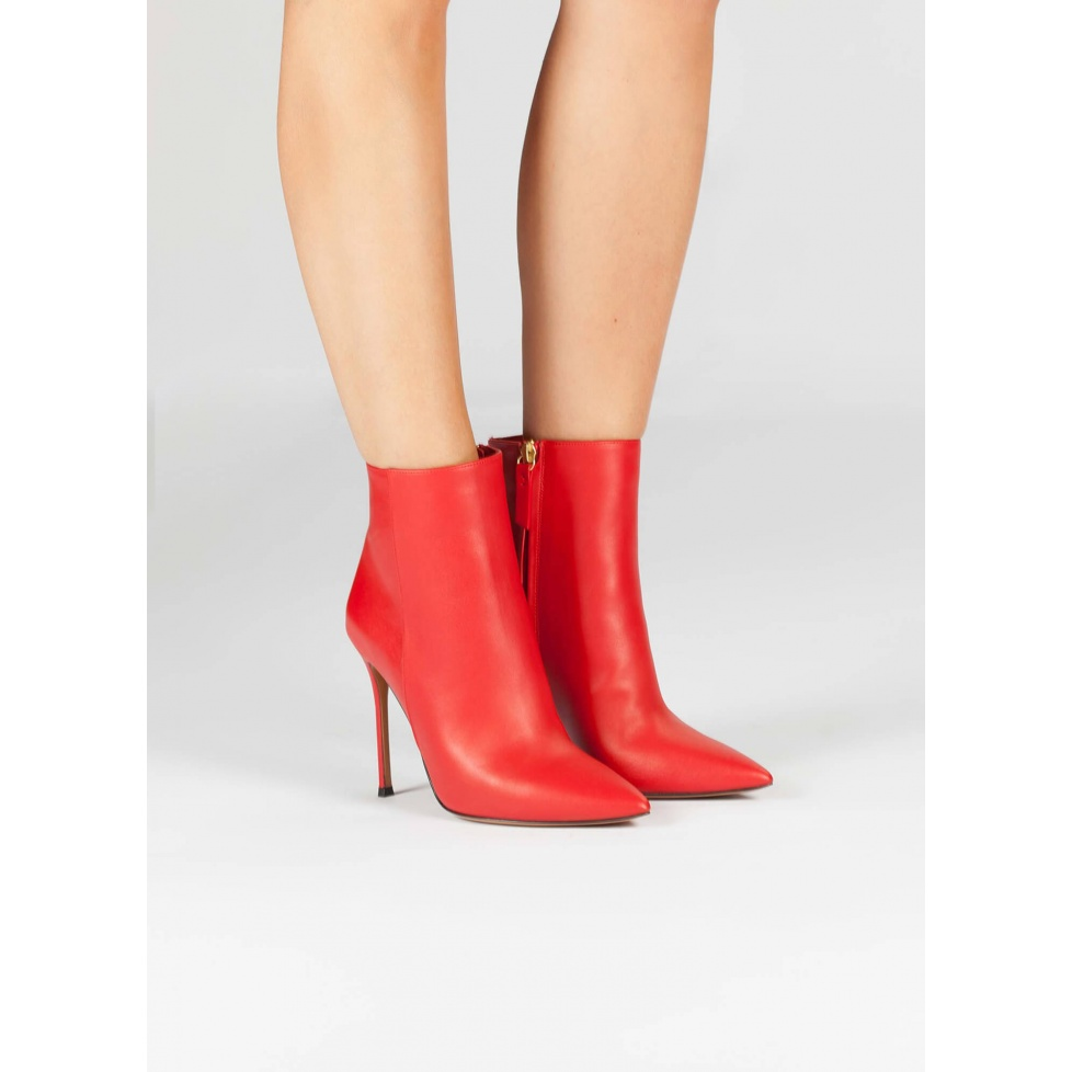 Red leather heeled pointy toe ankle boots