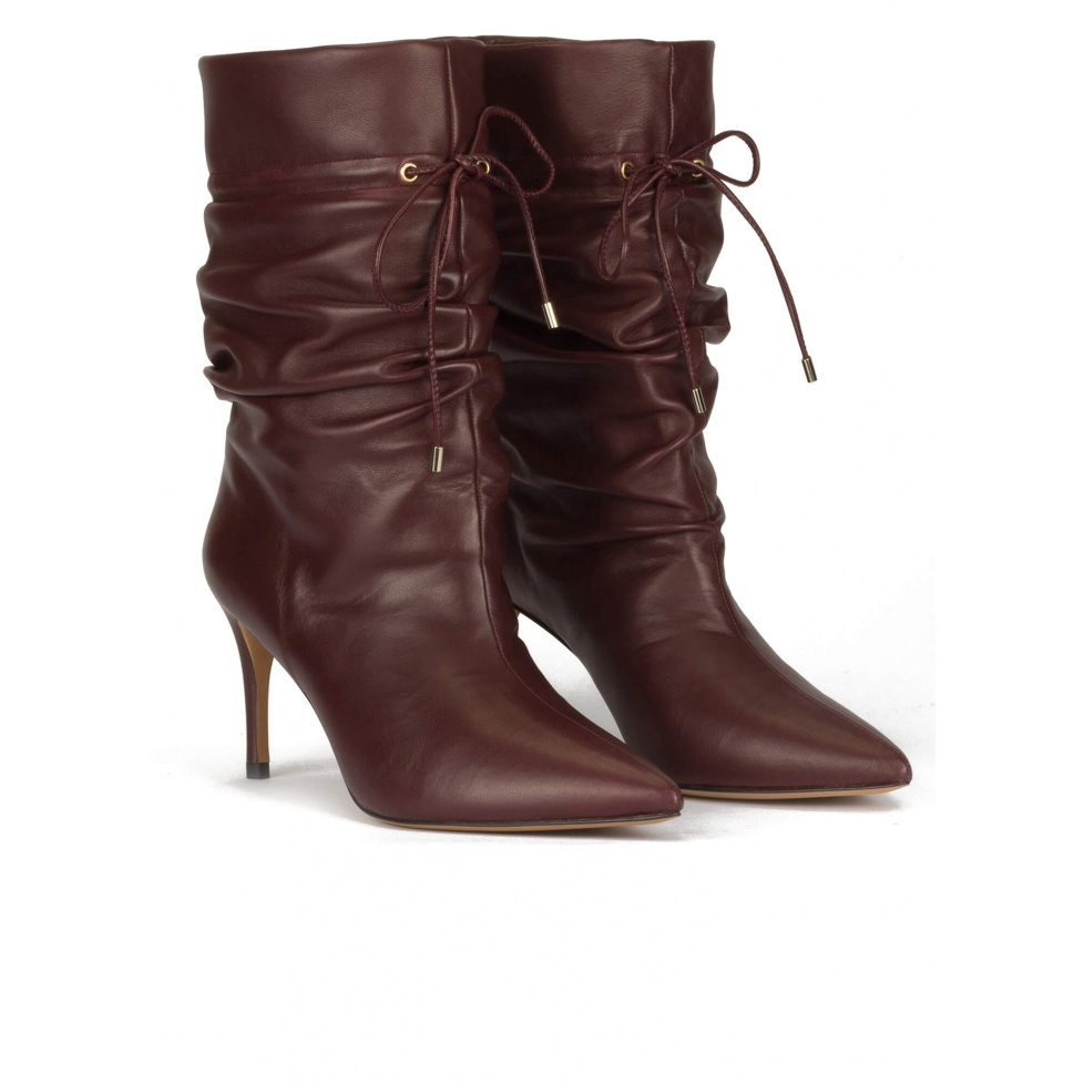Slouchy mid heel point-toe ankle boots in burgundy leather