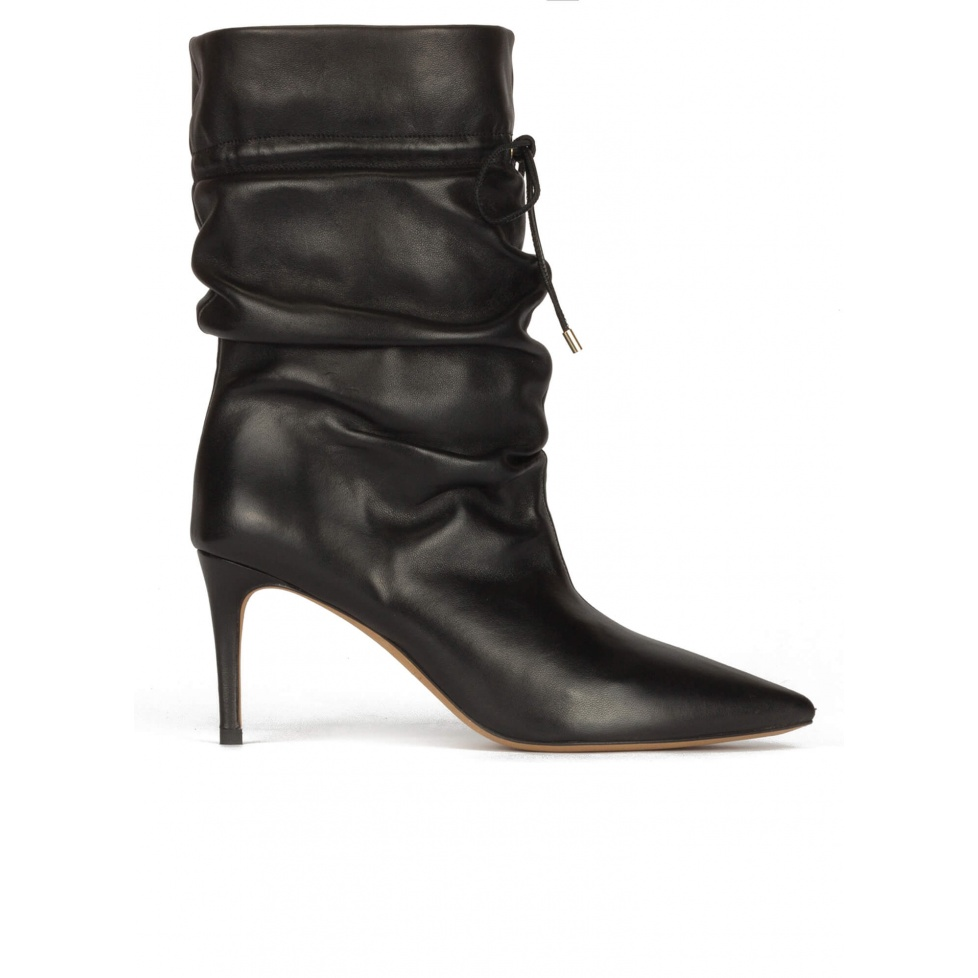 Slouchy mid-heel pointed toe ankle boots in black leather