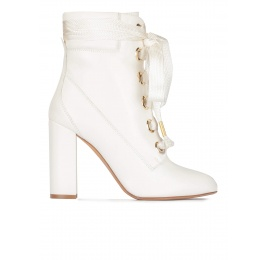 Off-white leather lace up high block heel ankle boots Pura López