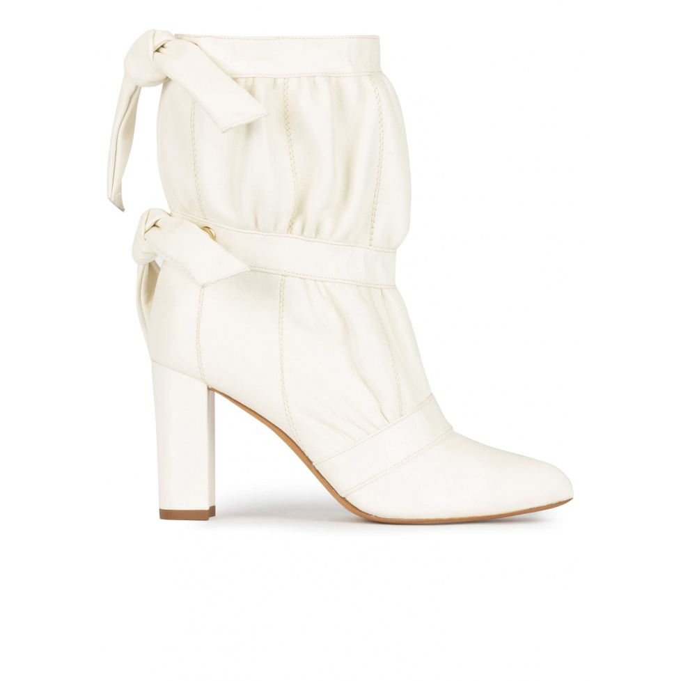 High block heel point-toe ankle boots in off-white leather