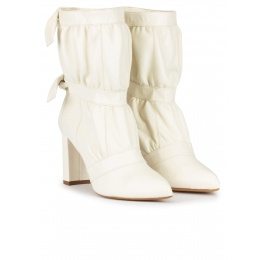 High block heel point-toe ankle boots in off-white leather Pura López