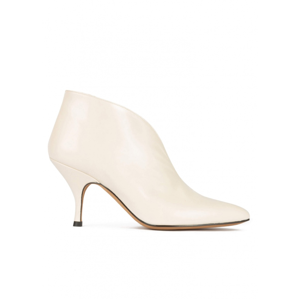 Curved heel pointy toe ankle boots in off-white leather