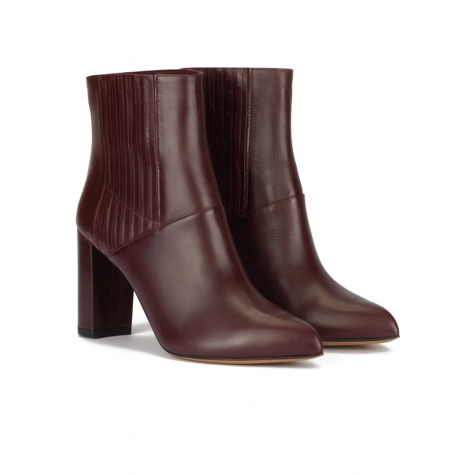 High block heel point-toe ankle boots in burgundy leather
