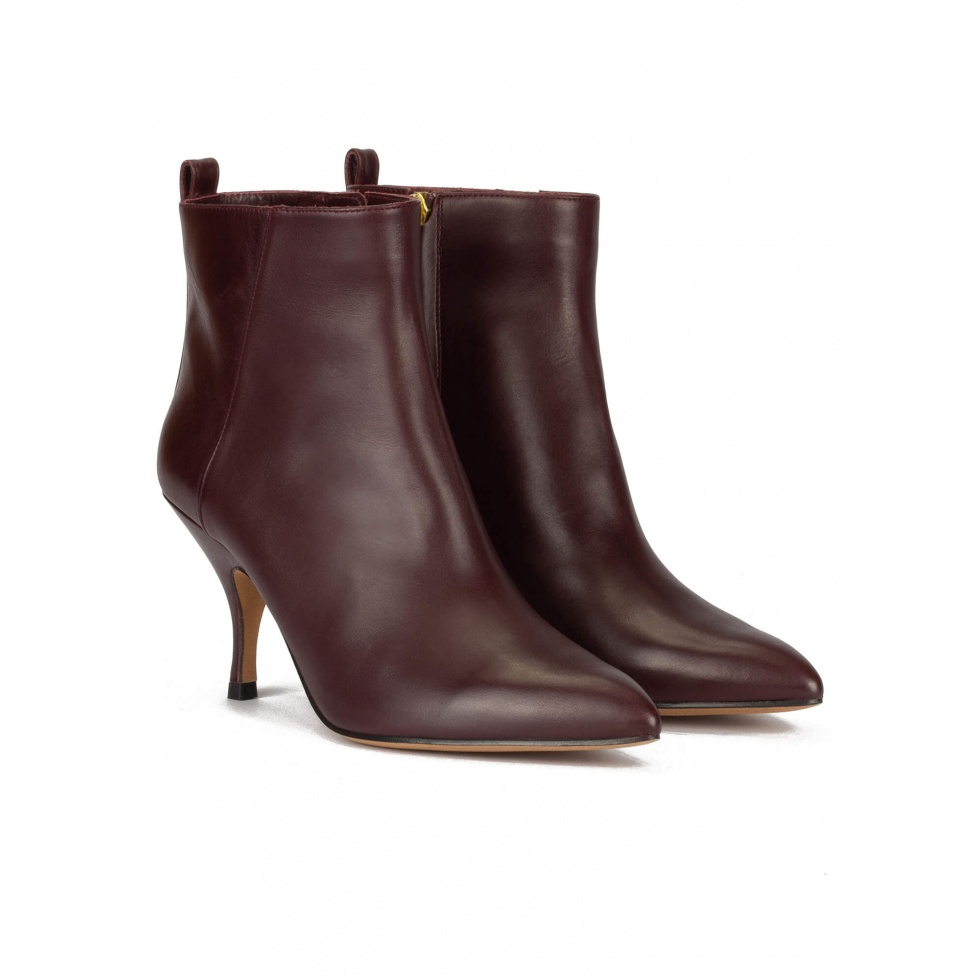 Curved heel point-toe ankle boots in burgundy leather