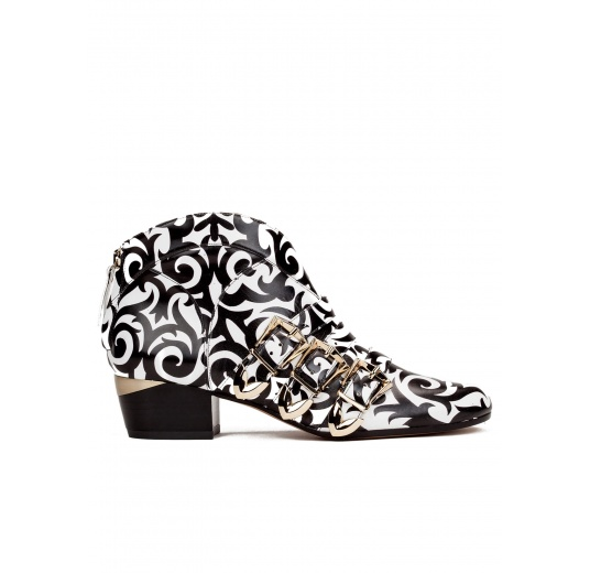 Mid heel ankle boots in black printed white leather Pura L�pez