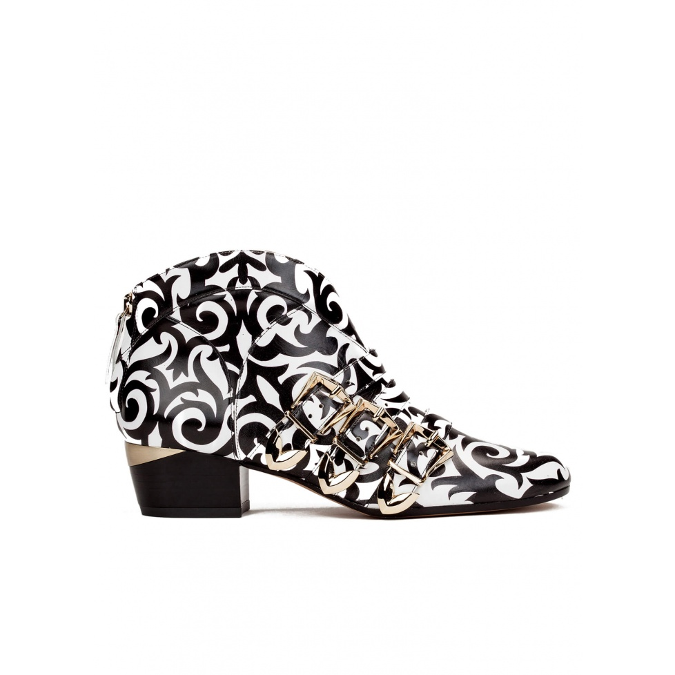 Mid heel ankle boots in black printed white leather