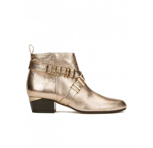 Mid heel ankle boots in champagne metallic leather with metal details Pura L�pez