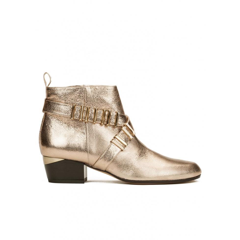 Mid heel ankle boots in champagne metallic leather with metal details