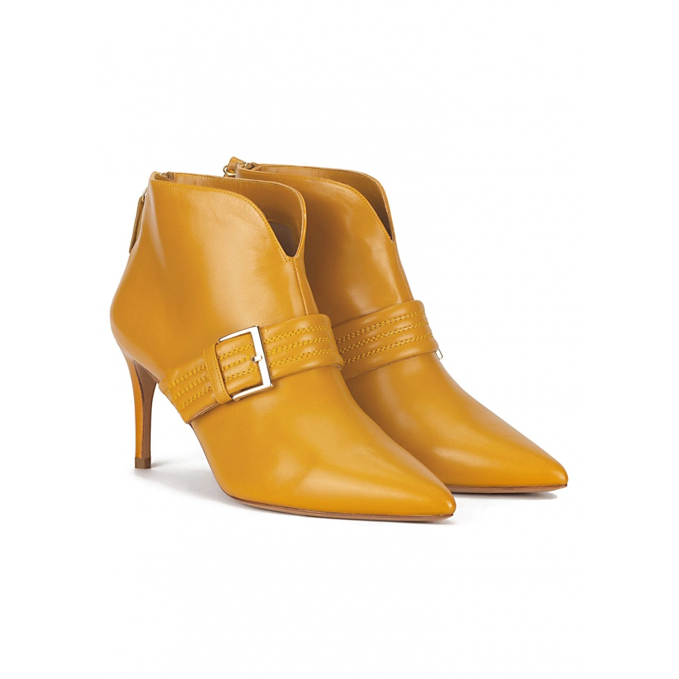 Buckle detailed mid heel ankle boots in mustard leather