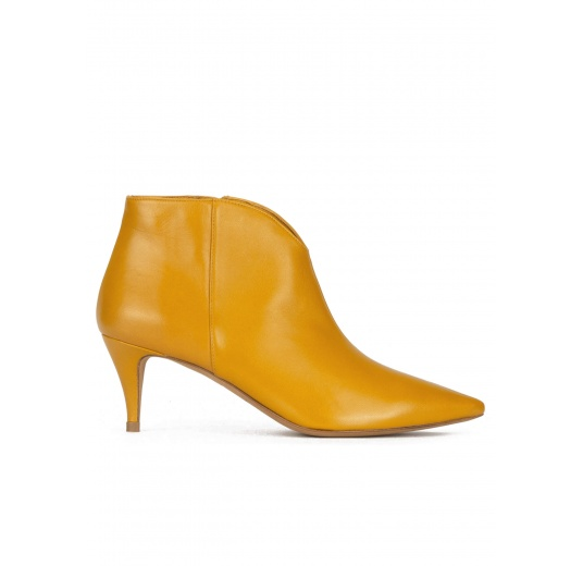 Mid heel ankle boots in mustard leather Pura L�pez