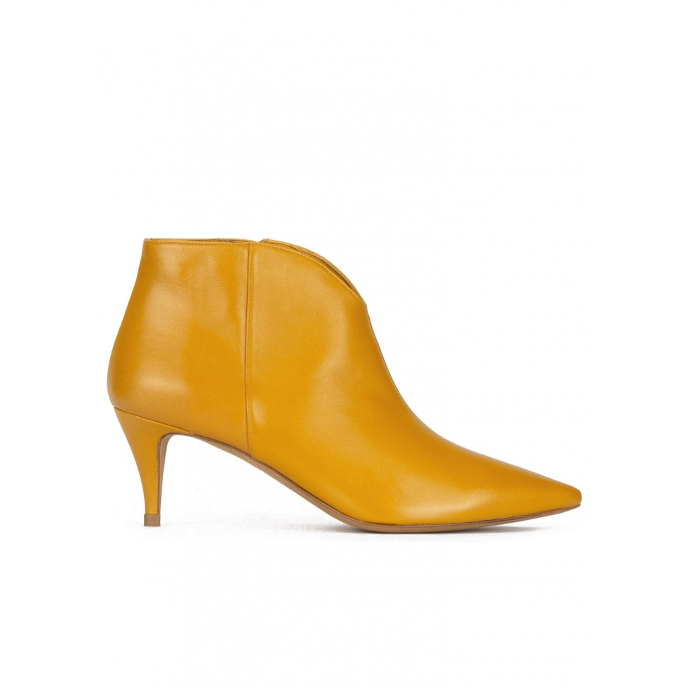 Mid heel ankle boots in mustard leather