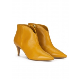 Mid heel ankle boots in mustard leather Pura López