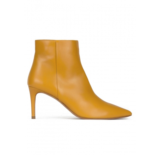 Mid heel pointy toe ankle boots in mustard leather Pura L�pez