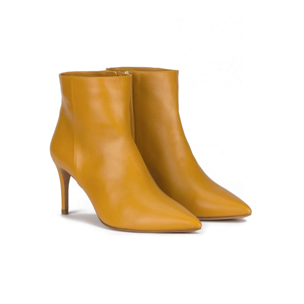 Mid heel pointy toe ankle boots in mustard leather