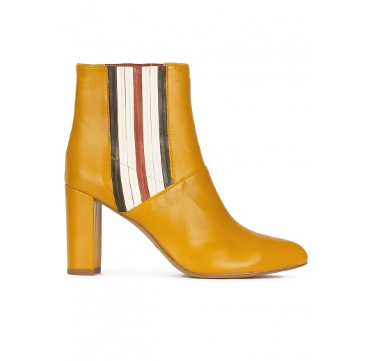 High block heel point-toe ankle boots in mustard leather Pura L�pez