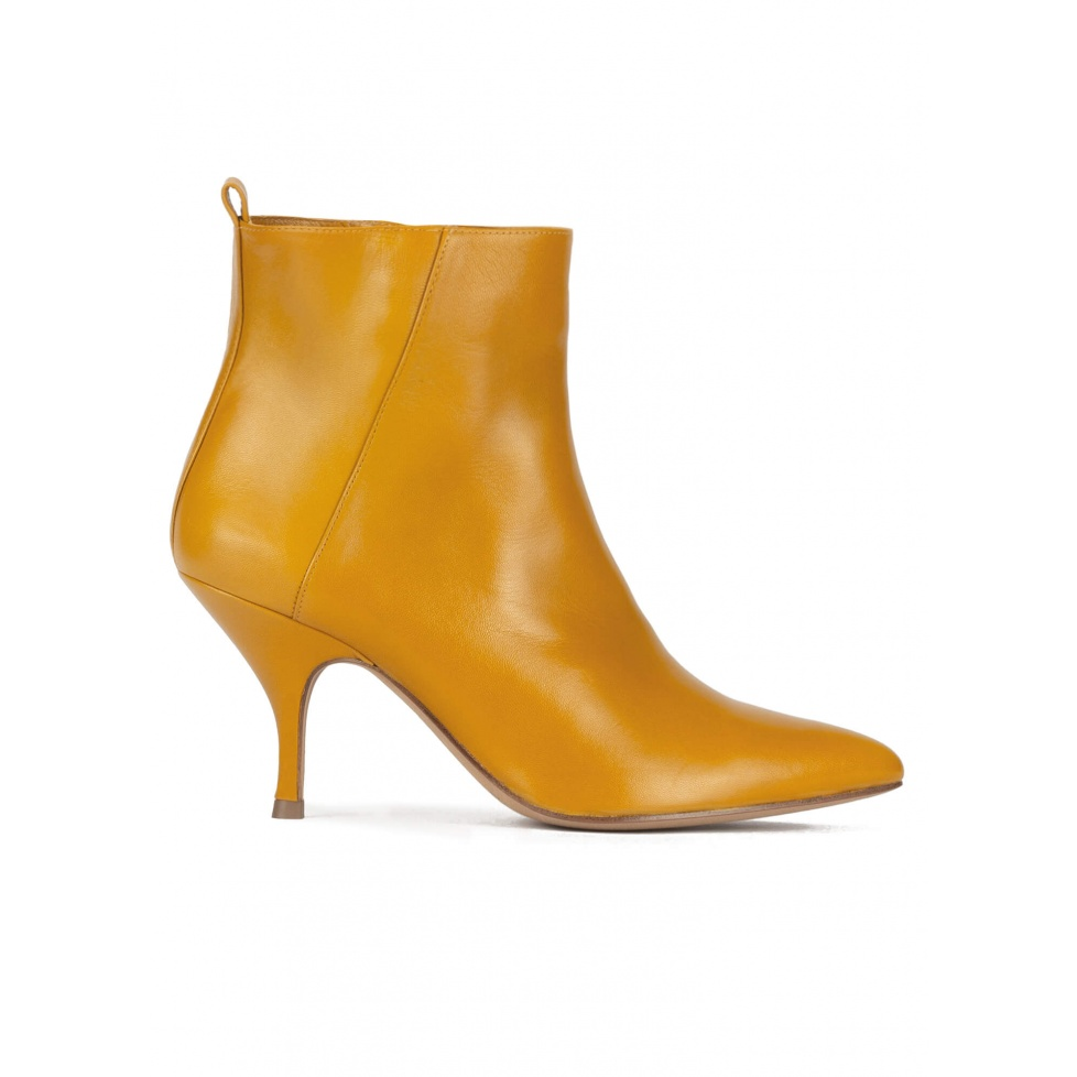 Mid heel pointed toe ankle boots in mustard leather