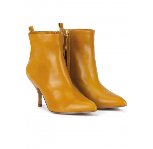 Mid heel pointed toe ankle boots in mustard leather Pura L�pez