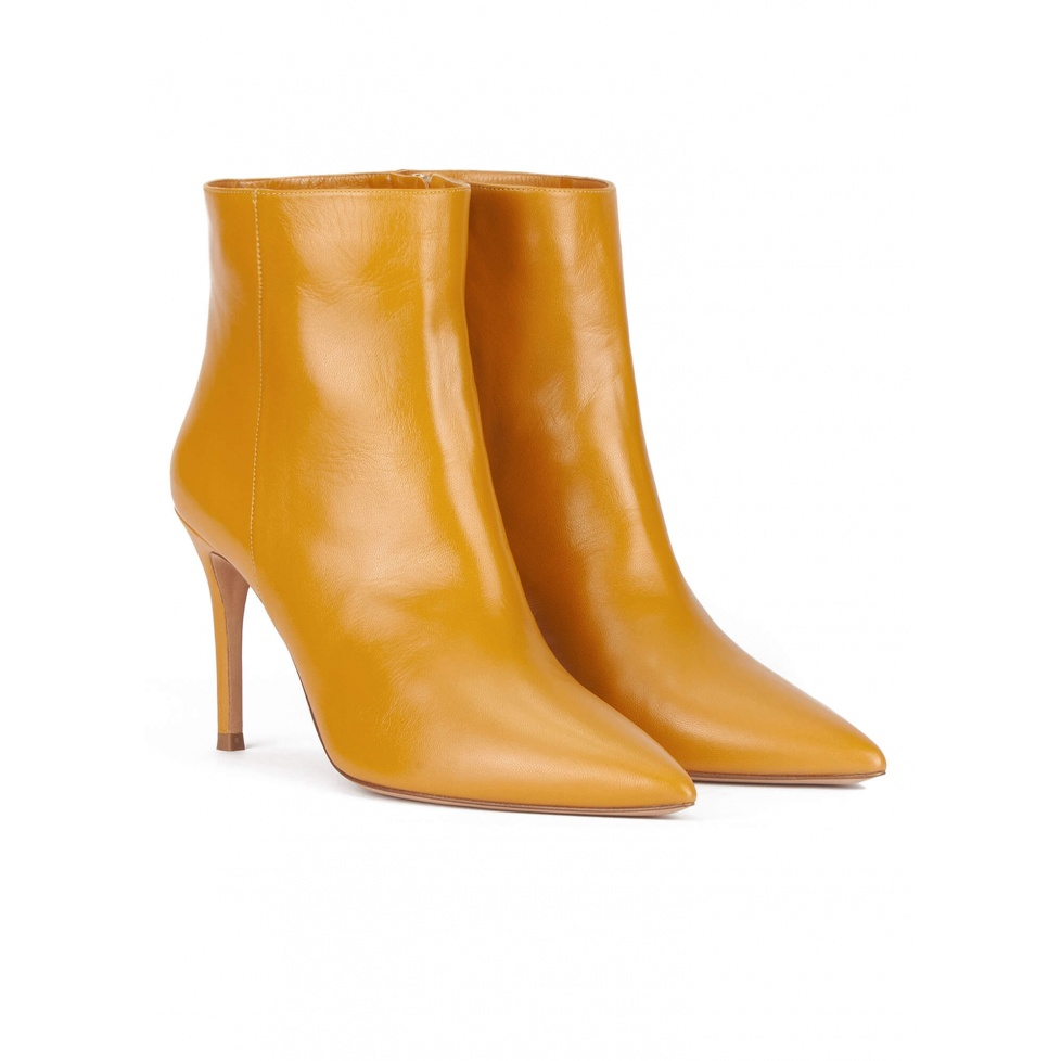 Mustard leather high heel point-toe ankle boots