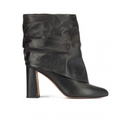 Black leather slouch high block heel ankle boots Pura López