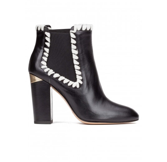 Elasticated high block heel ankle boots in black leather Pura L�pez