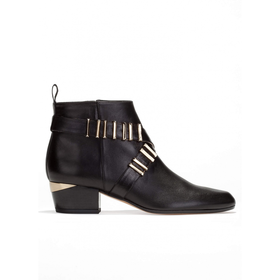 Mid heel ankle boots in black leather with metal details