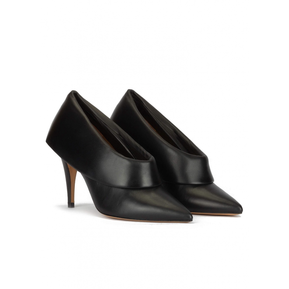 Black leather high heel shoes with folded panels