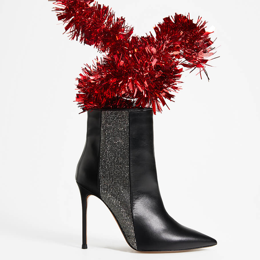 Heeled pointed toe ankle boots in black leather with strass panel
