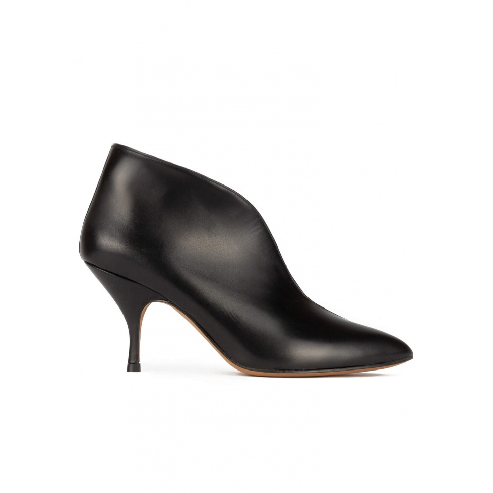 Curved heel point-toe ankle boots in black leather