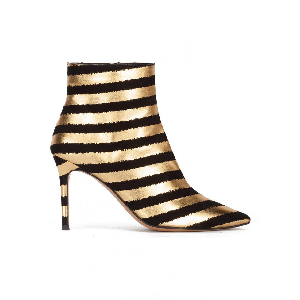 Botines de rayas con tacón alto y punta fina en colores oro y negro