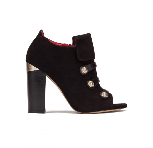 High block heel ankle boots in black suede and leather with metallic buttons Pura L�pez