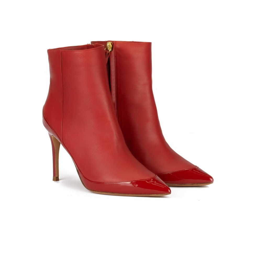 High heel pointed toe ankle boots in tile red leather