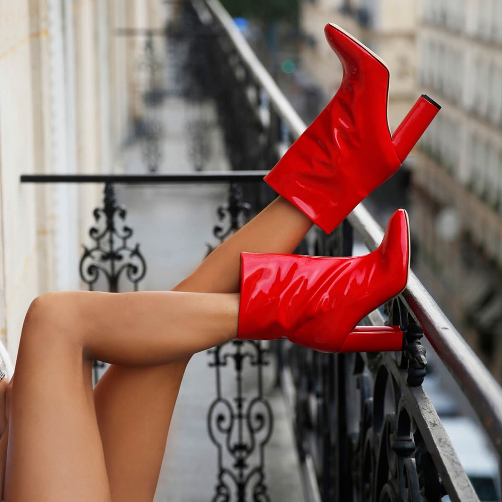 Red high block heel ankle boots in patent