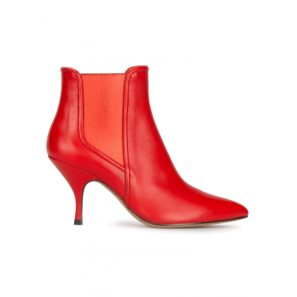 Curved heel point-toe ankle boots in red leather with elastic